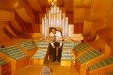 Photograph of Dr Vilhelm Jordan in a model of the Concert Hall dated 13 November 1981.