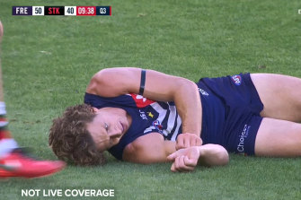 Fremantle's Nat Fyfe had to be helped from the ground after the brutal head clash with St Kilda's Josh Battle.