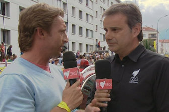 Mitchelton-Scott sporting director Matt White speaks to SBS commentator Michael Tomalaris in France at a previous Tour.