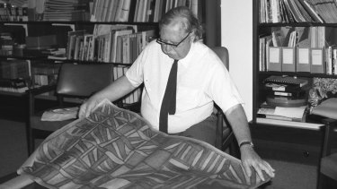 Professor Ronald Berndt at the University of WA with a rare Aboriginal painting.