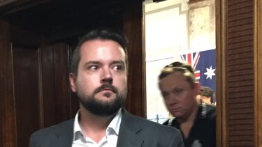 Queensland police remove Jared Cassidy from council chambers in November 2019.