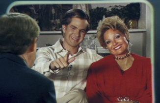 Andrew Garfield as Jim Bakker and Jessica Chastain as Tammy Faye Bakker in The Eyes Of Tammy Faye.