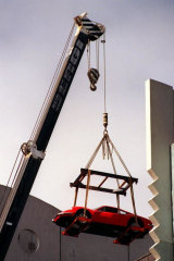 Adrian Valmorbida's $100,000 Ferrari Dino is moved by crane from his eight floor bedroom in 1998.
