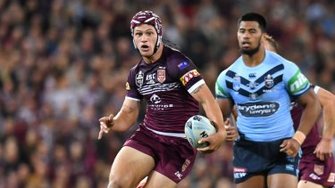 One step ahead: Kalyn Ponga makes a break for Queensland in Origin I.