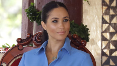 Meghan during a visit to Tupou College in Tonga. She wore the same outfit again on a tour of South Africa.