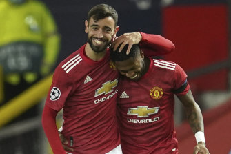 Bruno Fernandes and Fred celebrate the first of the former's two early goals in Manchester United's big win over Istanbul Basaksehir.