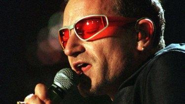 U2 singer Bono performing during the 1990s.