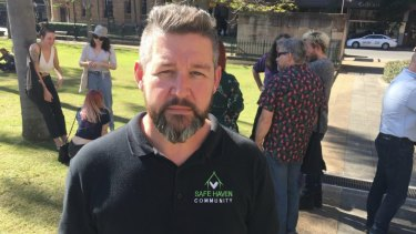 Men speak out against domestic violence on women at a rally in Queens Park. Paul Ferry from Safe Haven Community.