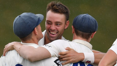 Got him: NSW's Harry Conway (centre) celebrates taking the wicket of Victoria's Matt Short on Wednesday.
