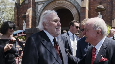 Rapprochement: One of the great feuds of Sydney has ended. John Laws and Alan Jones exchange pleasantries at the funeral of John Fordham in Paddington last November.