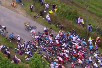An aerial view of the crash caused by a person with a sign on the first day of the Tour de France.