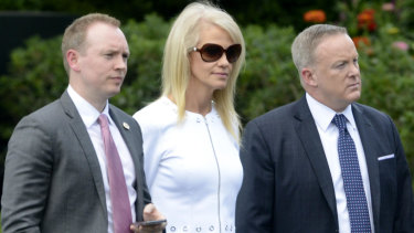 Cliff Sims (left) pictured with White House advisor Kellyanne Conway and former press secretary Sean Spicer in 2017.