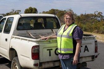 WIRES volunteer Janine Green collecting the dead kangaroos.