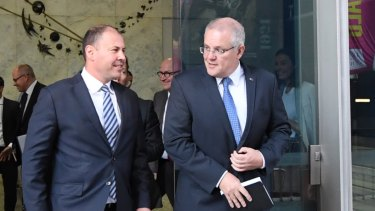 Treasurer Josh Frydenberg and Prime Minister Scott Morrison as they left the Reserve Bank following their meeting with governor Philip Lowe on Wednesday.