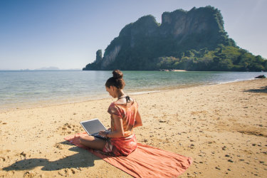 <p>Woman freelance on laptop computer at tropical, exotic beach. Koh Phi Phi. Thailand</p>