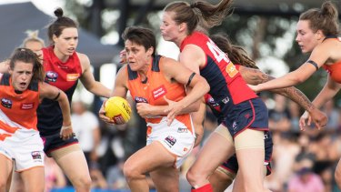 Courtney Gum plays midfield for the Giants and is mum to four-year-old Buz.