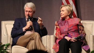 Money-makers: Bill and Hillary Clinton have seen their reputations questioned as their wealth has grown.