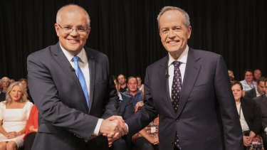 Prime Minister Scott Morrison and Opposition Leader Bill Shorten shake hands ahead of the debate.