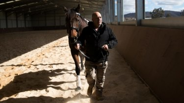 Retired serviceman Max Streeter, who suffers from PTSD, interacts with Vashka, a retired racing horse.