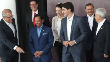 Prime Minister Scott Morrison, left, shares a joke with Brunei Sultan Haji Hassanal Bolkiah (in blue) and other leaders, at the APEC summit in Port Moresby, Papua New Guinea, in November.