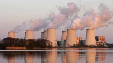 Exhaust plumes from cooling towers at the Jaenschwalde brown coal-fired power station in eastern Germany.