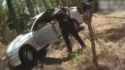 Alleged car thief gets 'stuck in mud' during escape after ramming police car