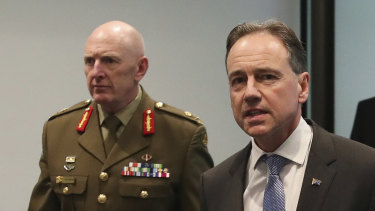 COVID-19 vaccine rollout chief Lieutenant-General John Frewen with federal Health Minister Greg Hunt.