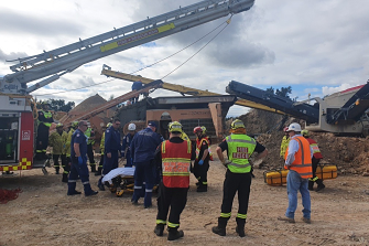 Fire and Rescue NSW safely removed a man who was trapped in rock crushing machinery at a quarry in Railway Street, Emu Plains this afternoon.