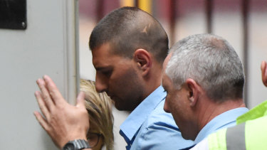 Jospeh Esmaili (centre) departs the Supreme Court of Victori on Wednesday to serve his 10-year sentence.
