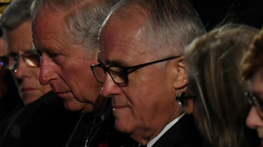 The Portaloo wasn't too far ... then Prime Minister Malcolm Turnbull with Prince Charles at the Anzac Day dawn service at Villers-Bretonneux last year.