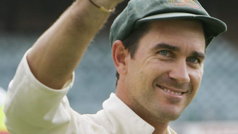 Justin Langer celebrates victory in his 100th Test.