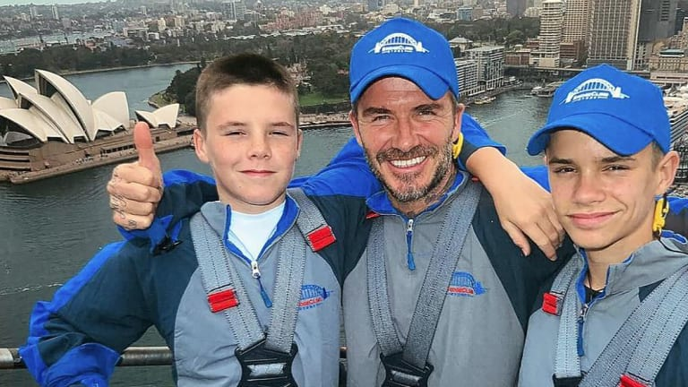 David Beckham with sons Cruz (L) and Romeo climbing the Sydney Harbour Bridge on Wednesday.