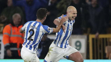 Recovery: Huddersfield's Aaron Mooy (right) has recovered from the injury that kept him out of the Asian Cup.