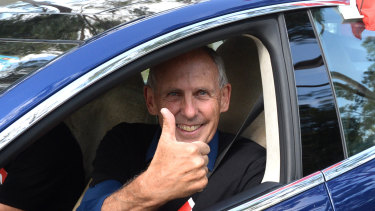 Former Greens leader Bob Brown leaves in a Tesla vehicle after attending an anti-Adani rally in Sydney.