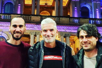 Refugee campaigner Craig Foster, centre, with Mostafa Moz' Azimitabar, left, and Farhad Bandesh, who were long held in captivity but are now free.