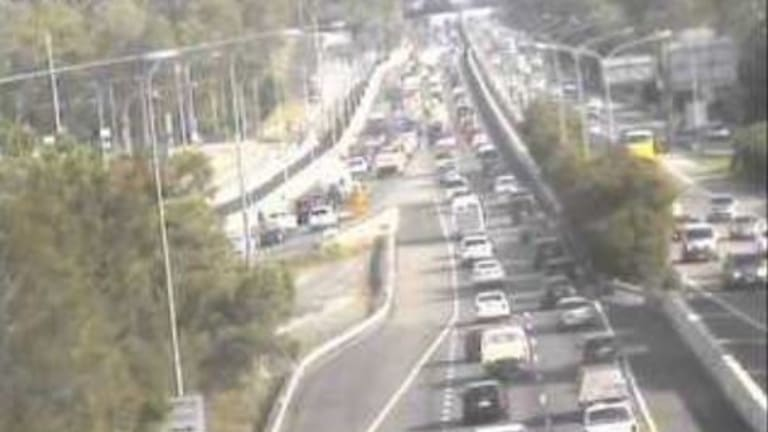 The car fire closed two northbound lanes and created congestion in both directions as emergency services responded.