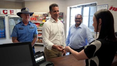 Racing and Gaming Minister Paul Papalia, centre, has announced a banned drinkers register for the Kimberley