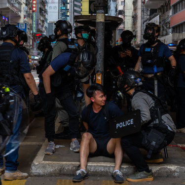 A pro-democracy supporter is detained by police during an anti-government rally on May 24 in Hong Kong.