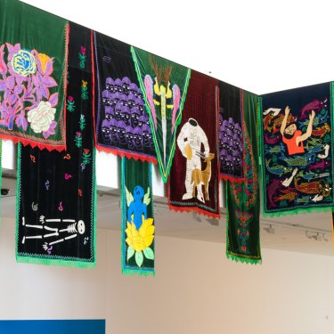 """Embroidered hangings feature in Mr Raad's other piece for QAGOMA, """"Garden Nights""""."""