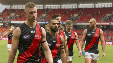 Essendon leave the field after the loss to GWS.