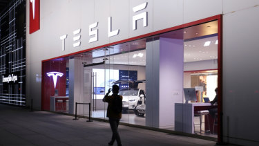 Chinese consumers may opt for European and Japanese cars instead of popular American brands like Tesla, its Beijing shop above, which will become more expensive with the new tariffs.