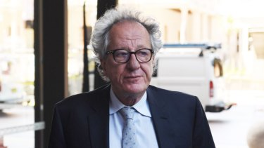 Geoffrey Rush leaves the Federal Court in Sydney on November 8.
