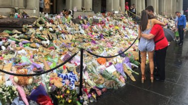 People leave tributes after a car mowed down pedestrians on Bourke Street in January 2017.