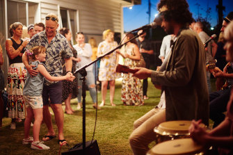 Bobby Alu performs at a backyard gathering for Parlour Gigs.