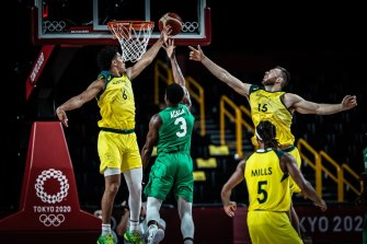Australian Boomers guard Josh Green (number six) attempts to block Nigeria's Caleb Agada.