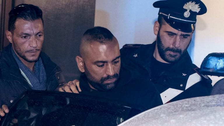 Ostia crime figure Roberto Spada, middle, after his arrest in January.