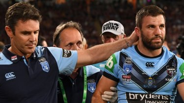 Brad Fittler consoles James Tedesco after a head knock forced him from the field.