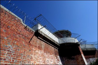 Former attorney-general Bob Debus says tackling the drivers of crime through justice reinvestment policies would help reduce the prison population.