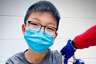 Caleb Chung, 12, was one of the volunteers in the Pfizer vaccine study in the US.