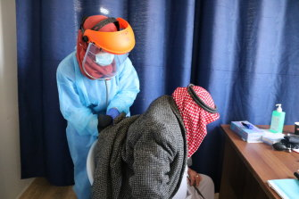 A medic helps a patient in the Doctors Without Borders clinic in Hebron.